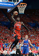 SPORT - Perth Wildcats v Adelaide 36er's at Perth Arena. Photo By Daniel Wilkins. PICTURED- Perth's James Ennis prepares to slam the ball as Adelaide's Adam Doyle watches on.