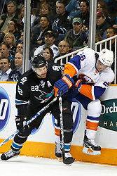 November 11, 2010; San Jose, CA, USA;  San Jose Sharks defenseman Dan Boyle (22) checks New York Islanders left wing Matt Moulson (26) against the boards during the first period at HP Pavilion. Mandatory Credit: Jason O. Watson / US PRESSWIRE