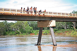 Local kids line up to jump off the bridge at Fitzroy Crossing.