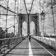 The Brooklyn Bridge opened in 1883. At the time, it was the longest suspension bridge in the world. <br />
