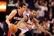 Feb. 15, 2012; Phoenix, AZ, USA; Phoenix Suns forward Markieff Morris (11) guards the Atlanta Hawks guard Kirk Hinrick (6) during the second half at the US Airways Center. The Hawks defeated the Suns 101-99. Mandatory Credit: Jennifer Stewart-US PRESSWIRE.