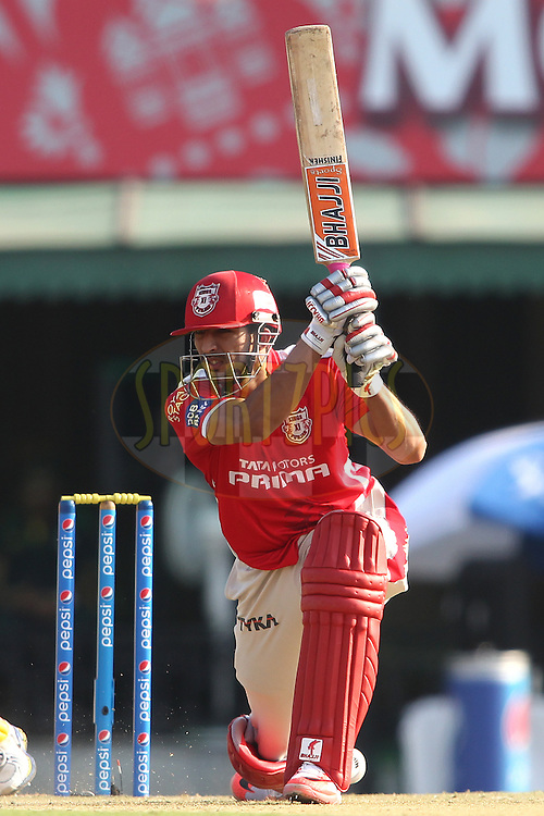 Rishi Dhawan of Kings XI Punjab drives a delivery during match 53 of the Pepsi IPL 2015 (Indian Premier League) between The Kings XI Punjab and The Chennai Super Kings held at the Punjab Cricket Association Stadium in Mohali, India on the 16th May 2015.<br /> <br /> Photo by:  Shaun Roy / SPORTZPICS / IPL
