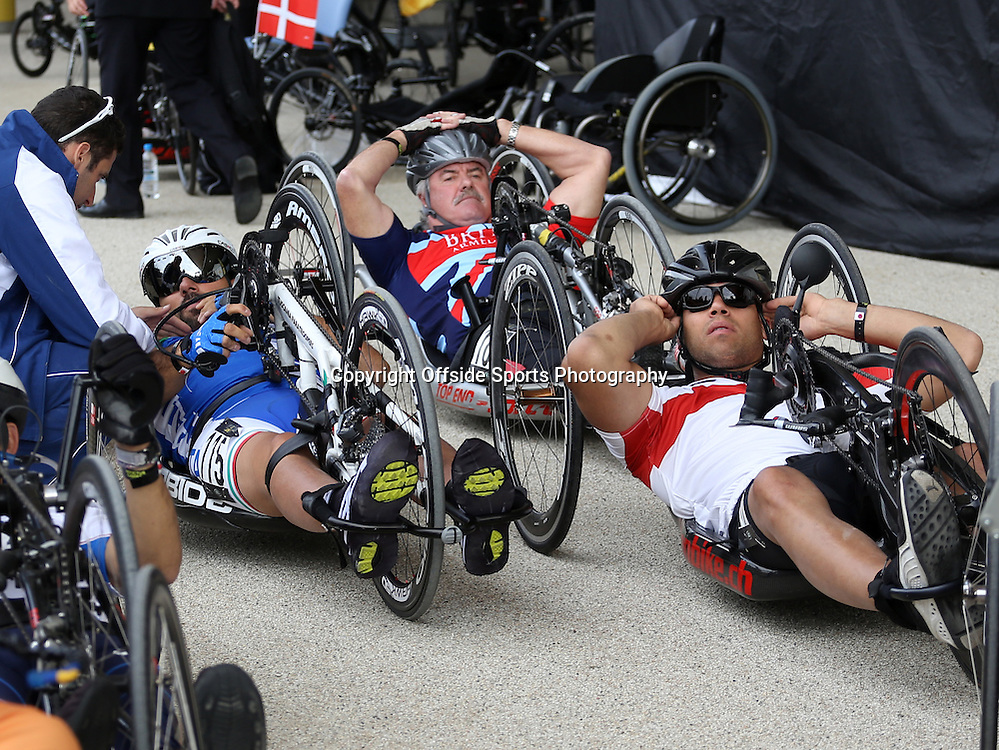 13 September 2014 - Invictus Games Day 3 - The hand bike riders relax before their turn to take to the track.<br /> <br /> Photo: Ryan Smyth/Offside