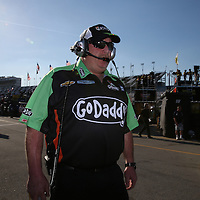 Danica Patrick's Crew Chief Tony Gibson walks through the garage area during the  56th Annual NASCAR Daytona 500 practice session at Daytona International Speedway on Wednesday, February 19, 2014 in Daytona Beach, Florida.  (AP Photo/Alex Menendez)