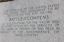 "Dedication on the U.S. Memorial Monument at Cowpens National Battlefield Park, Cowpens, South Carolina, March 17, 2008.  Inscription reads ""The Congress of The United States has caused this monument to be erected on the site of the Battle of Cowpens as a testimonal to the valor and in appreciation of the services of the American troops on this field in behalf of the independence of their country.""."