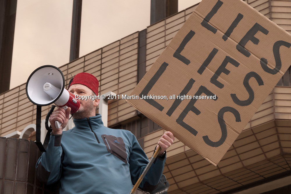 Protesters on an anti cuts demonstration outside the Liberal Democrat spring conference in Sheffield. 12-03-3011.