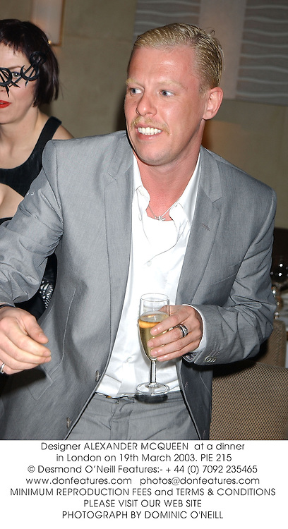 Designer ALEXANDER MCQUEEN  at a dinner in London on 19th March 2003.	PIE 215