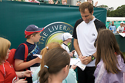 Liverpool, England - Tuesday, June 12, 2007: Greg Rusedski signs autographs on day one of the Liverpool International Tennis Tournament at Calderstones Park. For more information visit www.liverpooltennis.co.uk. (Pic by David Rawcliffe/Propaganda)