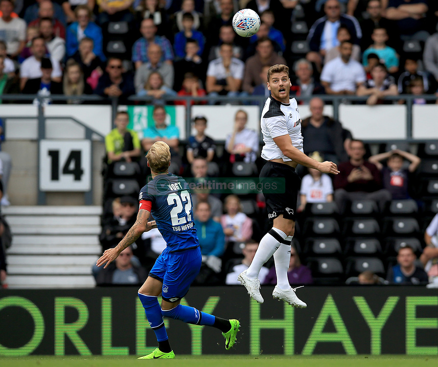 Derby County's Chris Martin (Right) and TSG 1899 Hoffenheim's Kevin Vogt contest a header.