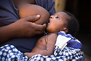 A woman breastfeeds her child. Northern Ghana, Thursday November 13, 2008.