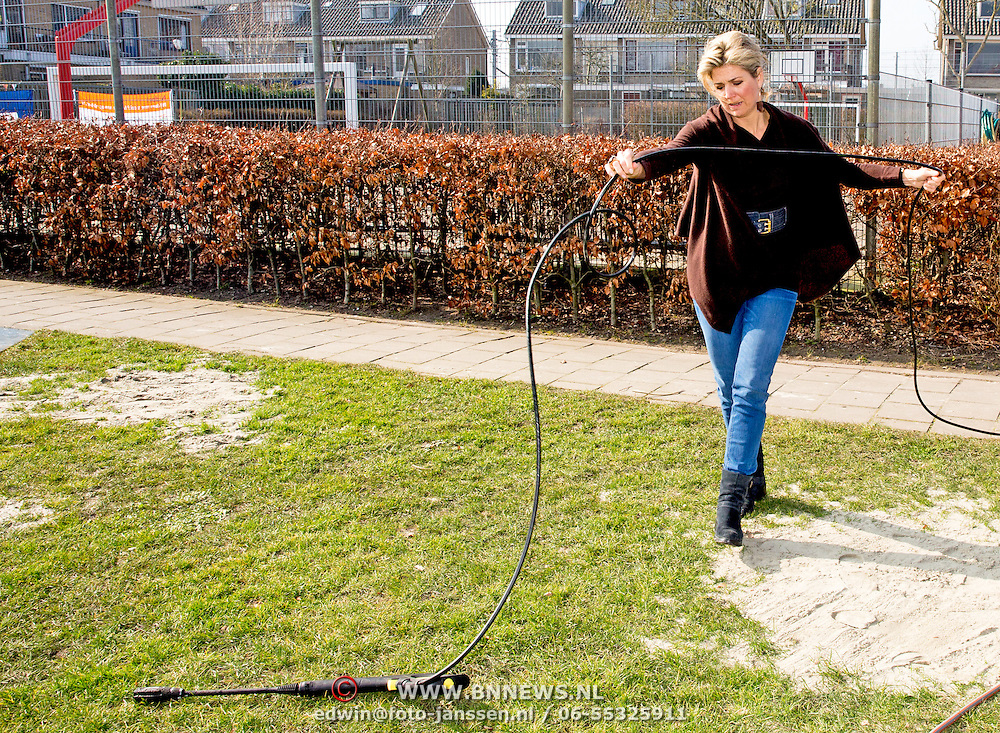 King Willem-Alexander and Queen Maxima of The Netherlands volunteering at playground and community Vreugdeoord in Alpen aan den Rijn, The Netherlands, 12 March 2016. NL Doet is in initiative of the Oranje Fonds, the King and Queen are patron and patroness of the foundation. Photo: Patrick van Katwijk<br /> <br /> Koning Willem-Alexander en Koningin Maxima nemen deel aan vrijwilligersactie NL Doet en klussen mee in speeltuin en buurtvereniging Vreugdeoord in Alpen aan den Rijn, 12 Maart 2015. NL Doet is een vrijwilligersactie van het Oranje Fonds, de koning en de koningin zijn beschermheer en beschermvrouwe van het fonds. Foto: Patrick van Katwijk