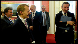 Lib Dem David Laws talks to Michael Gove as they wait to be appointted as new members of the cabinet by The Prime Minister David Cameron inside the Cabinet room of Number 10 Downing Street, Wednesday May 12, 2010. Photo By Andrew Parsons/i-Images