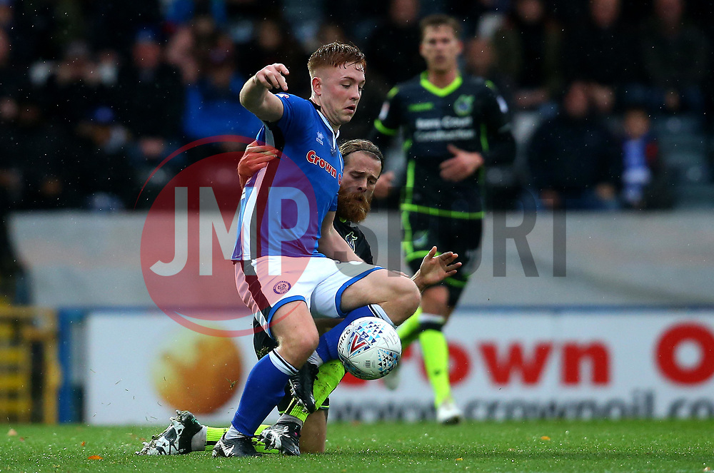Stuart Sinclair of Bristol Rovers challenges Callum Camps of Rochdale - Mandatory by-line: Robbie Stephenson/JMP - 21/10/2017 - FOOTBALL - Crown Oil Arena - Rochdale, England - Rochdale v Bristol Rovers - Sky Bet League One