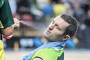 UNITED KINGDOM, London: 2015 World Wheelchair Rugby Challenge. Caption: South Africa's Jared McIntyre gets a cooling down spray during the half time break. Rick Findler / Story Picture Agency