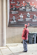 PALO ALTO, CA - NOVEMBER 26:  Willie Shaw looks at a historical display of Stanford quarterbacks in the field tunnel of Stanford Stadium during game between the Stanford Cardinal and the Rice Owls played on November 26, 2016  at Stanford Stadium in Palo Alto, California.  Willie Shaw's son David Shaw played and coached football at Stanford.  (Photo by David Madison/Getty Images)