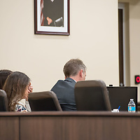 Defendant Deborah Green, left, rubs her eyes as the defense addresses the jury with opening statements during Day 1 of the Green Case at the 13th Judicial District Courthouse in Grants Tuesday afternoon.