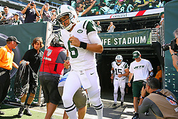 Sept 9, 2012; East Rutherford, NJ, USA; New York Jets quarterback Mark Sanchez (6) and New York Jets quarterback Tim Tebow (15) run onto the field during the pre-game warmup for their game against the Buffalo Bills at MetLIfe Stadium.