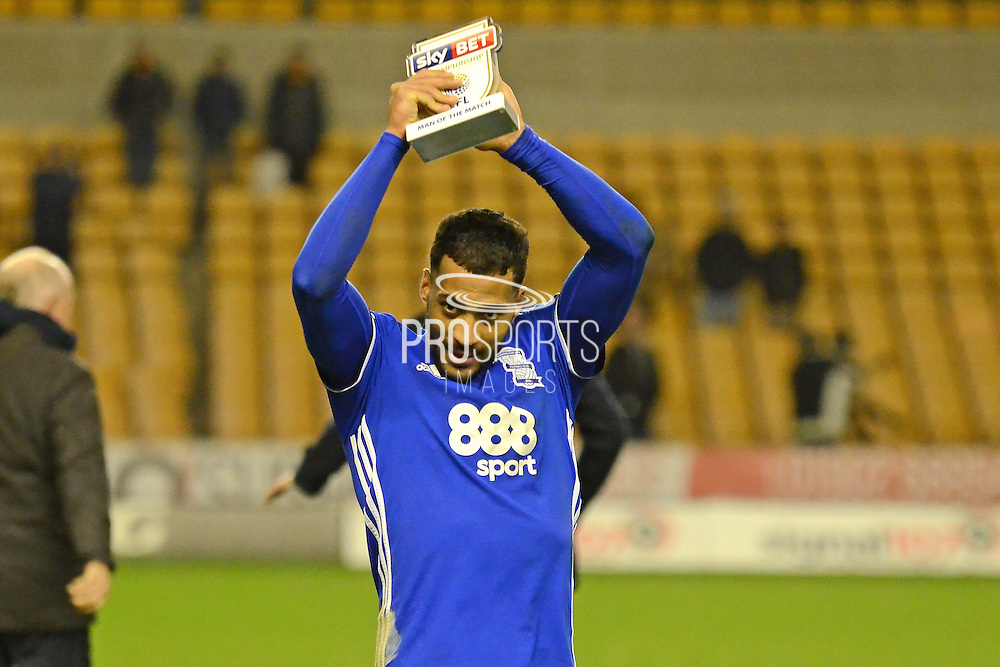 Birmingham City midfielder David Davis (26) celebrates with the man of the match award 1-2 during Wolverhampton Wanderers and Birmingham City at Molineux, Wolverhampton, England on 24 February 2017. Photo by Alan Franklin.