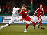 Photo: Richard Lane/Richard Lane Photography. Swindon Town v Norwich City. Coca-Cola Football League One. 20/03/2010. Norwich's Korey Smith challenges Swindon's Danny Ward (rt).