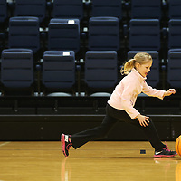 Lauren Wood | Buy at photos.djournal.com<br /> Sammie Harmon, 6, rolls a basketball while playing a game with other Mooreville Elementary first graders during their visit at the ICC-Fulton campus.