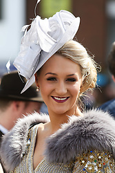 © Licensed to London News Pictures. 08/04/2016. Liverpool, UK. A glamorous woman wears a fur coat and hat on Ladies Day at the Grand National 2016 at Aintree Racecourse near Liverpool. The race, which was first run in 1839, is the most valuable jump race in Europe. Photo credit : Ian Hinchliffe/LNP