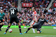 James Milner tackles Charlie Adam during the Barclays Premier League match between Stoke City and Liverpool at the Britannia Stadium, Stoke-on-Trent, England on 9 August 2015. Photo by Alan Franklin.