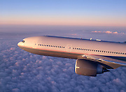 Airliner flying above puffy clouds