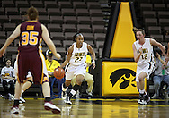 February 18, 2010: Iowa guard Kachine Alexander (21) brings the ball down court along with Iowa center Morgan Johnson (12) during the first half of the NCAA women's basketball game at Carver-Hawkeye Arena in Iowa City, Iowa on February 18, 2010. Iowa defeated Minnesota 75-54.
