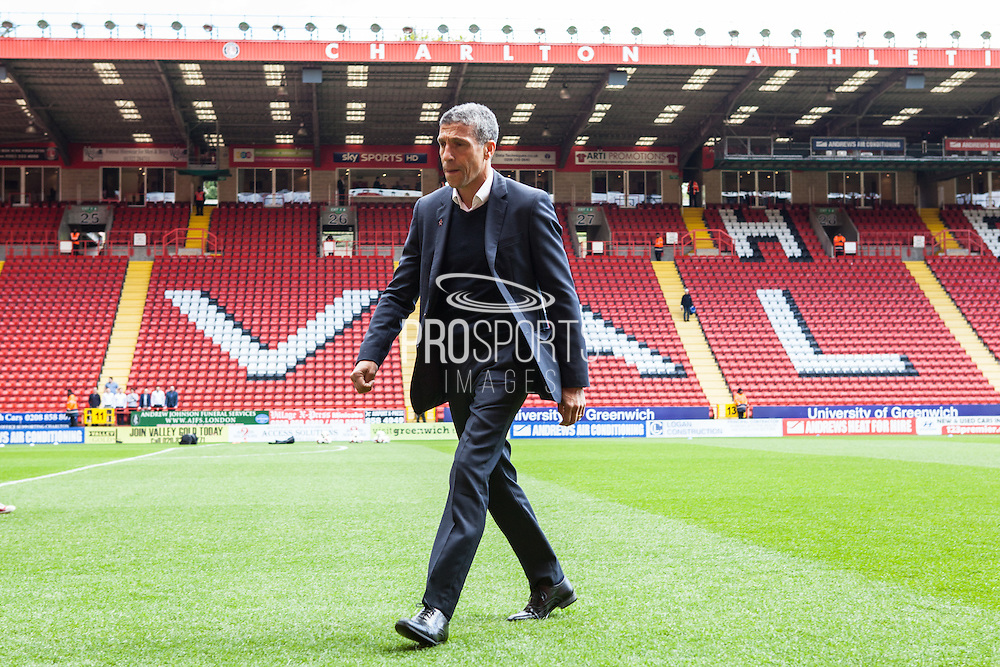 Brighton Manager Chris Hughton checks out the playing surface before the Sky Bet Championship match between Charlton Athletic and Brighton and Hove Albion at The Valley, London, England on 23 April 2016. Photo by Bennett Dean.