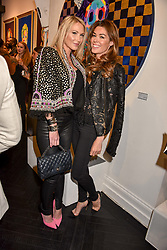 Left to right, Adela King and Sophie Stanbury at a private view of work by Bradley Theodore entitled 'The Second Coming' at the Maddox Gallery, 9 Maddox Street, London England. 19 April 2017.