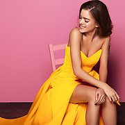 fashion photoshoot in a beautiful canary long dress, editorial style with a fashion model