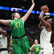 March 31, 2019; Portland, OR, USA;  Oregon Ducks forward Erin Boley (21) defends Mississippi State Bulldogs center Teaira McCowan (15) in the first half of Elite Eight of the NCAA Women's Tournament at Moda Center.<br /> Photo by Jaime Valdez