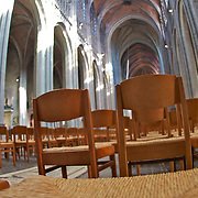 Chairs set up for mass at St. Waltrude's cathedral in Mons