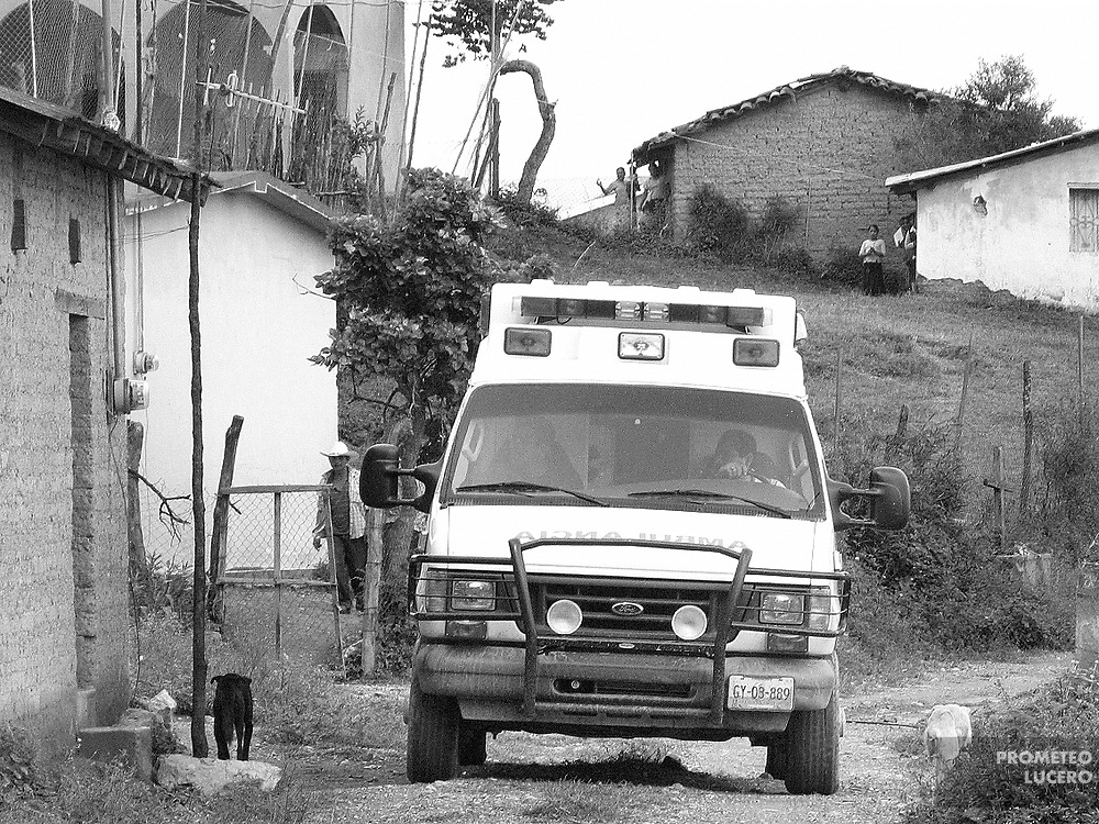 People look the passing of an ambulance that was assigned to pick Maurilia and take her into the nearest hospital, almost 4 hours away. Some said it was the first time ever they saw a vehicle like this.  (Prometeo Lucero)