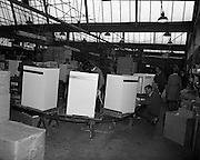Pye Factory,fridge assembly line..1971..15.04.1971..04.15.1971..15th April 1971..The Pye factory which manufactured electrical appliances closed its doors in 1985. At the peak it Pye employed 1200 people and was the largest employer in the Dundrum area. Dundrum bowl was built on the Pye site when the factory closed, it too had its problems and closed in the early 90s due to flooding. on the site now stands the Dundrum Shopping centre which is now the centrepoint of Dundrum town centre..Photograph of the assembly line where the various components are put together in the final assembly of the fridges.
