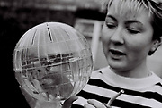 Girl with her hamster in a ball, UK, 1985.