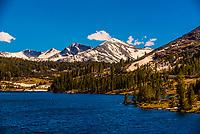 Tioga Lake on Tioga Pass, driving through the Sierra Nevada Mountains to the eastern entrance of Yosemite National Park, California USA.