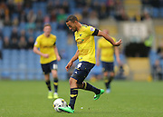 Oxford United midfielder Kemar Roofe (4) in action during the Sky Bet League 2 match between Oxford United and AFC Wimbledon at the Kassam Stadium, Oxford, England on 10 October 2015.