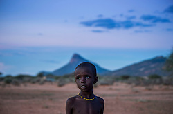 A child wakes up before the sun comes up to take their family's goats out for grazing in the Melako Conservancy in Northern Kenya. Melako is a vast expanse of arid bushland that stretches towards the Ethiopian and Somali border. Rainfall is rare, as are permanent settlements and solid infrastructure, yet the community have been grazing this rangeland for decades. <br /> One of the most important parts of Melako becoming part of the Northern Rangelands Trust   is the security it brings to the communities. Today, community rangers are on daily patrol in Melako and these community conservancies have transformed people&rsquo;s lives, secured peace and help them to conserve natural resources.