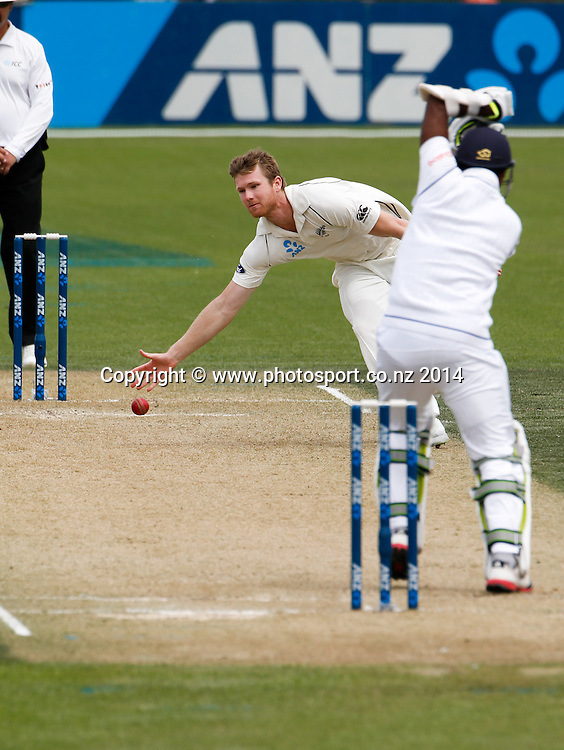 Jimmy Neesham fields off his own bowl. Day 2, ANZ Boxing Day Cricket Test, New Zealand Black Caps v Sri Lanka, 27 December 2014, Hagley Oval, Christchurch, New Zealand. Photo: John Cowpland / www.photosport.co.nz