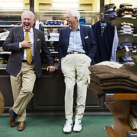 Jimmy Long, left, laughs with Henry Dodge during Long's retirement reception at MLM Clothiers in downtown Tupelo.