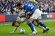 Marlon Pack of Cardiff City challenges Connor Roberts of Swansea City during the EFL Sky Bet Championship match between Cardiff City and Swansea City at the Cardiff City Stadium, Cardiff, Wales on 12 January 2020.
