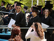 Middletown, NY - A graduate smiles for the cell phone camera after receiving his diploma during the 58th commencement at Orange County Community College on May 17, 2008.