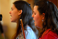 15 MAY 2010 -- O'FALLON, Ill. -- Cheryl Schaefer (right) and Allison Niesen, members of the band Celtica, based in Belleville, Ill., perform during the new Saturday Evening Celtic Service held at the church building New Creations Presbyterian Church shares with St. Michael's Episcopal Church in O'Fallon, Ill. Mary 15, 2010. New Creation plans to host a Celtic service once a month, as part of newly-instituted Saturday night services. Image © copyright 2010 by Sid Hastings.