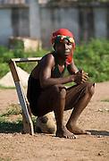 Boy sitting on football in Accra, Ghana, 2006.