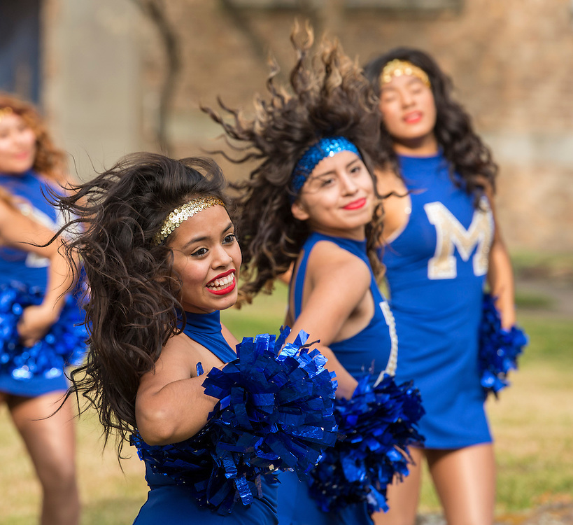 Dance team members perform during a groundbreaking ceremony at Milby High School, December 18, 2014.