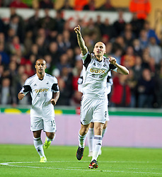 SWANSEA, WALES - Monday, September 16, 2013: Swansea City's Jonjo Shelvey celebrates scoring the first goal against Liverpool during the Premiership match at the Liberty Stadium. (Pic by David Rawcliffe/Propaganda)