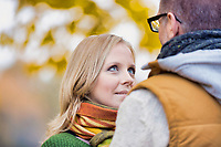 Portrait of beautiful woman showing affection while talking to her husband in park