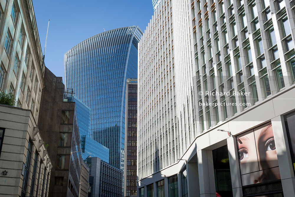 A pair of eyes and surrounding City of London offices on Fenchurch Street - in the heart of the capital's financial district (aka The Square Mile), on 24th September 2018, in London, England.