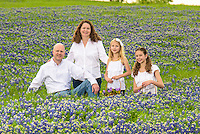 Russell, Jennifer and family family portrait captured in a beautiful field of bluebonnets